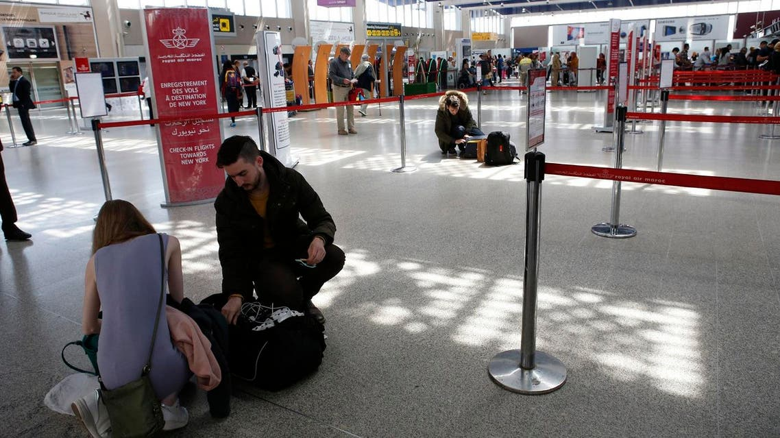 Passengers store their electronic items in their suitcases and bags when arriving at the Casablanca-New York flight zone at Casablanca Mohammed V International Airport on Thursday, March 29, 2017. (AP)