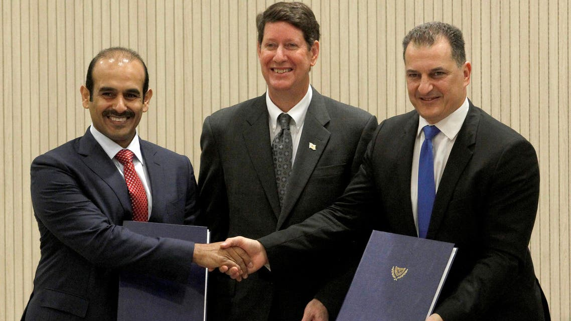 Cyprus' Minister of Energy Yiorgos Lakkotrypis (right) poses with CEO of Qatar Petroleum Saad Sharida Al Kaabi (left) and Vice President of Exxon Mobil Andrew Swiger during an official signing ceremony in Nicosia on April 5, 2017. (Reuters)