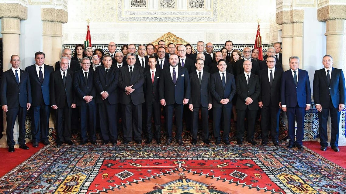 An official handout from the royal palace shows the Morocco's King Mohammed VI (C) , the Crown Prince Moulay Hassan (L of the King ) and the new Prime Minister Saadeddine Othmani (R of the king) posing with others ministers in the royal palace of Rabat on April 5, 2017. AFP