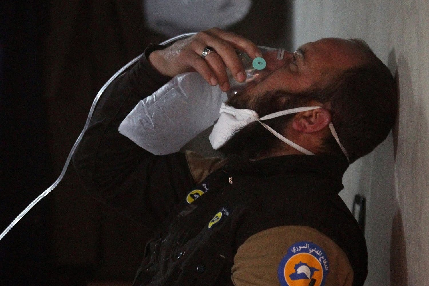 A civil defense member breathes through an oxygen mask, after what rescue workers described as a suspected gas attack in the town of Khan Sheikhoun in rebel-held Idlib. (Reuters)