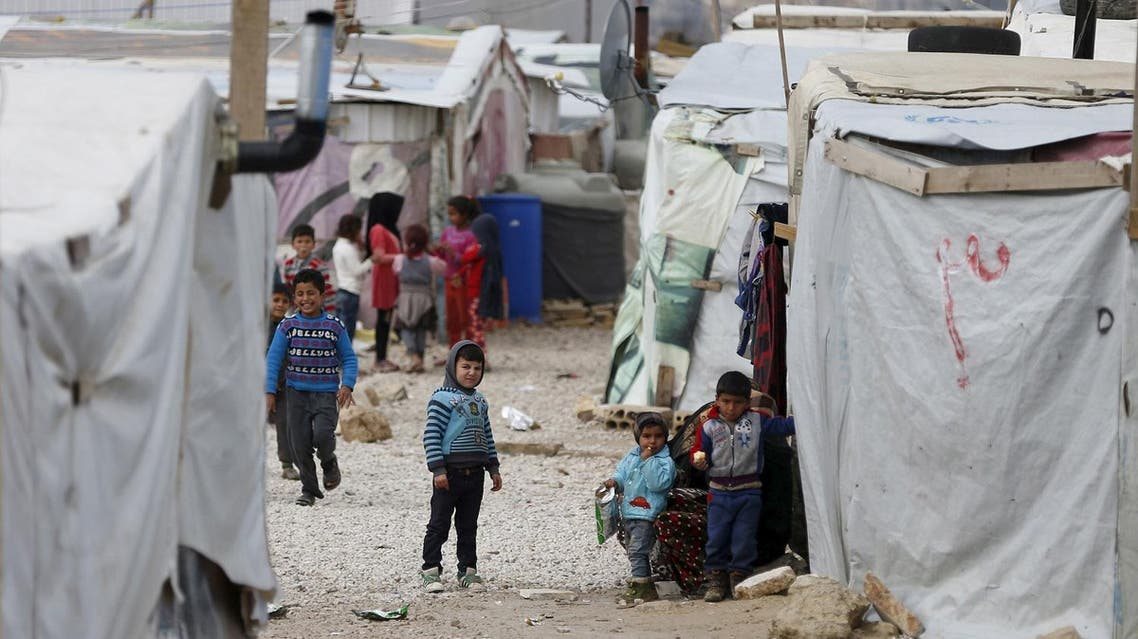 Syrian children are seen inside an informal settlement for Syrian refugees in Bar Elias, Bekaa valley, Lebanon, January 6, 2016. More than 1 million Syrians are enduring another winter as refugees in Lebanon. For some, it is their fifth in a row, displaced by a war that has driven 4.4 million Syrians into neighbouring states from where many are trying to reach Europe. REUTERS/ Jamal Saidi