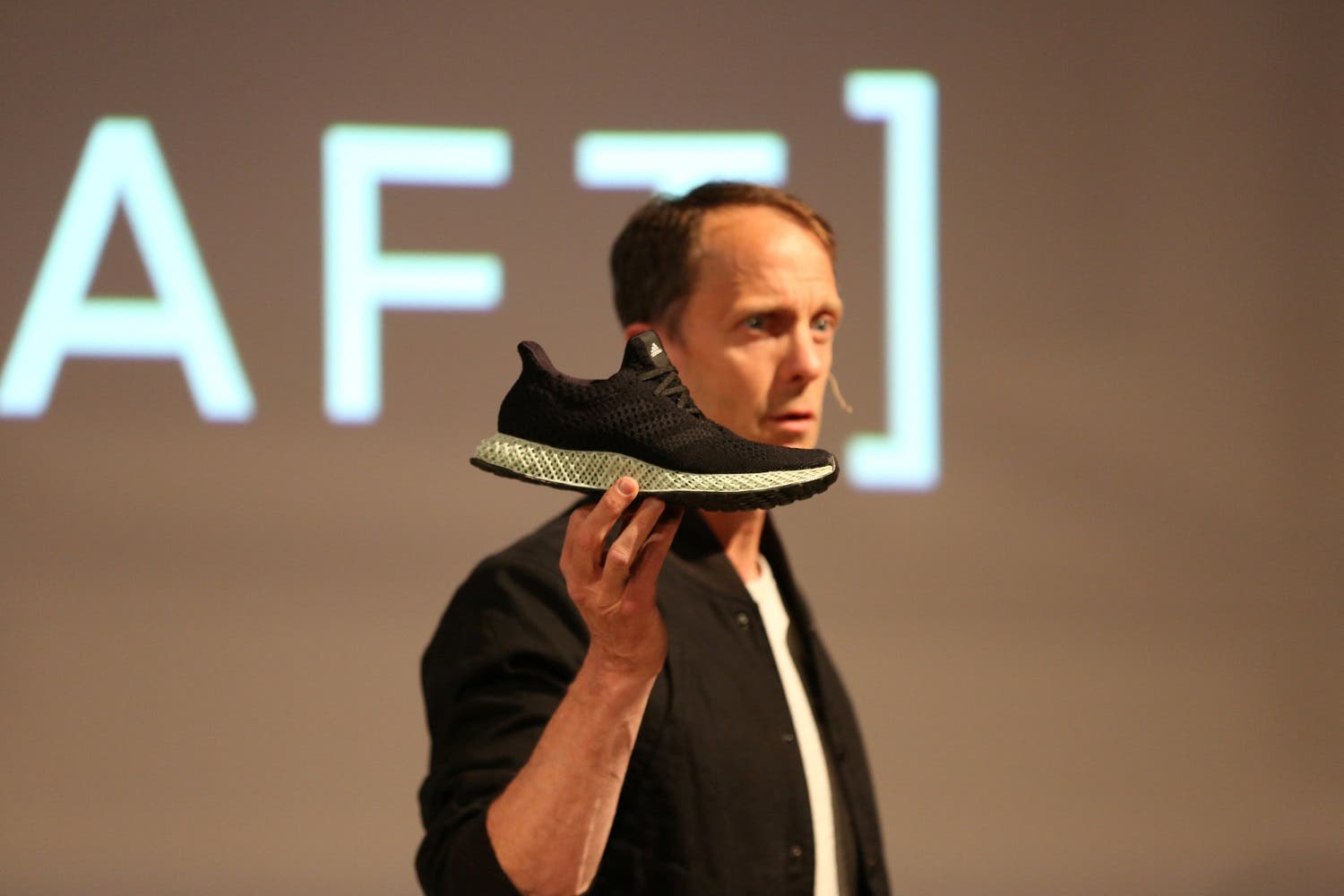 Adidas Executive Board Global Brands member Eric Liedtke holds the new Futurecraft shoe at an unveiling event in New York City, on April 6, 2017. (Reuters)