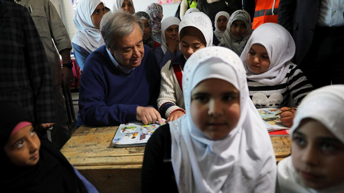 United Nations Secretary General Antonio Guterres reads a book with Syrian children during his visit to Al Zaatari refugee camp in the Jordanian city of Mafraq, near the border with Syria on March 28, 2017. (Reuters)