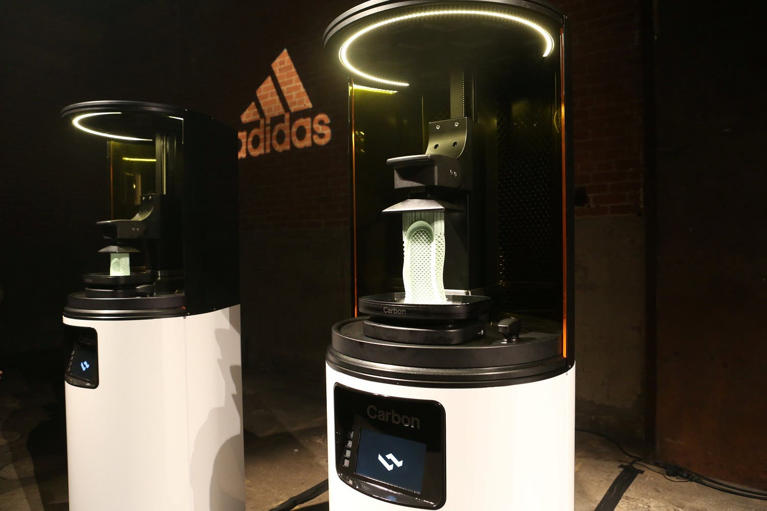 Carbon 3D printing machines are seen at an unveiling event for the new Adidas Futurecraft shoe in New York City, on April 6, 2017. (Reuters)