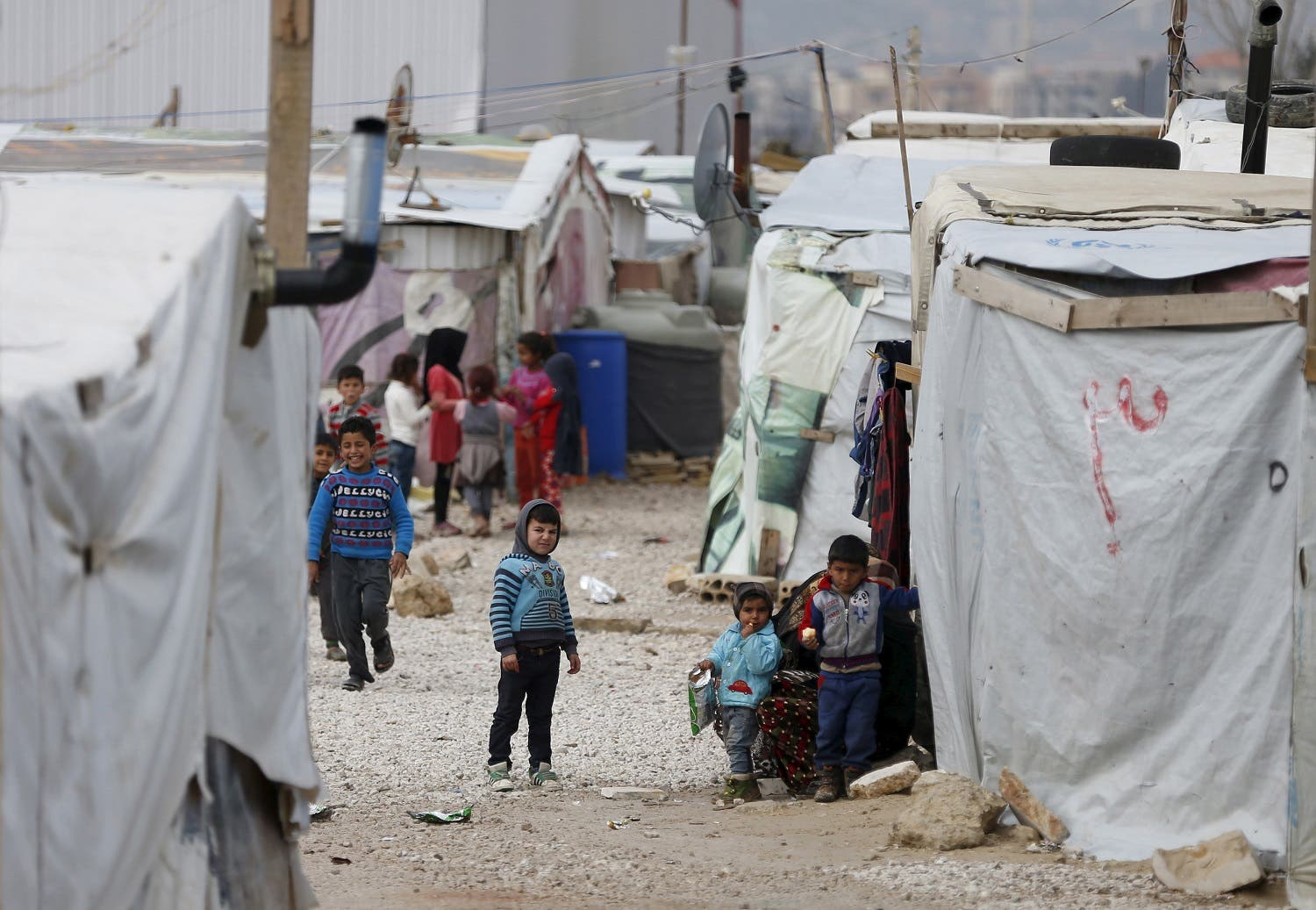 Syrian refugee children are seen outside their makeshift house at an unofficial refugee camp in the village of Deir Zannoun in Lebanon's Bekaa valley. (File photo: Reuters)