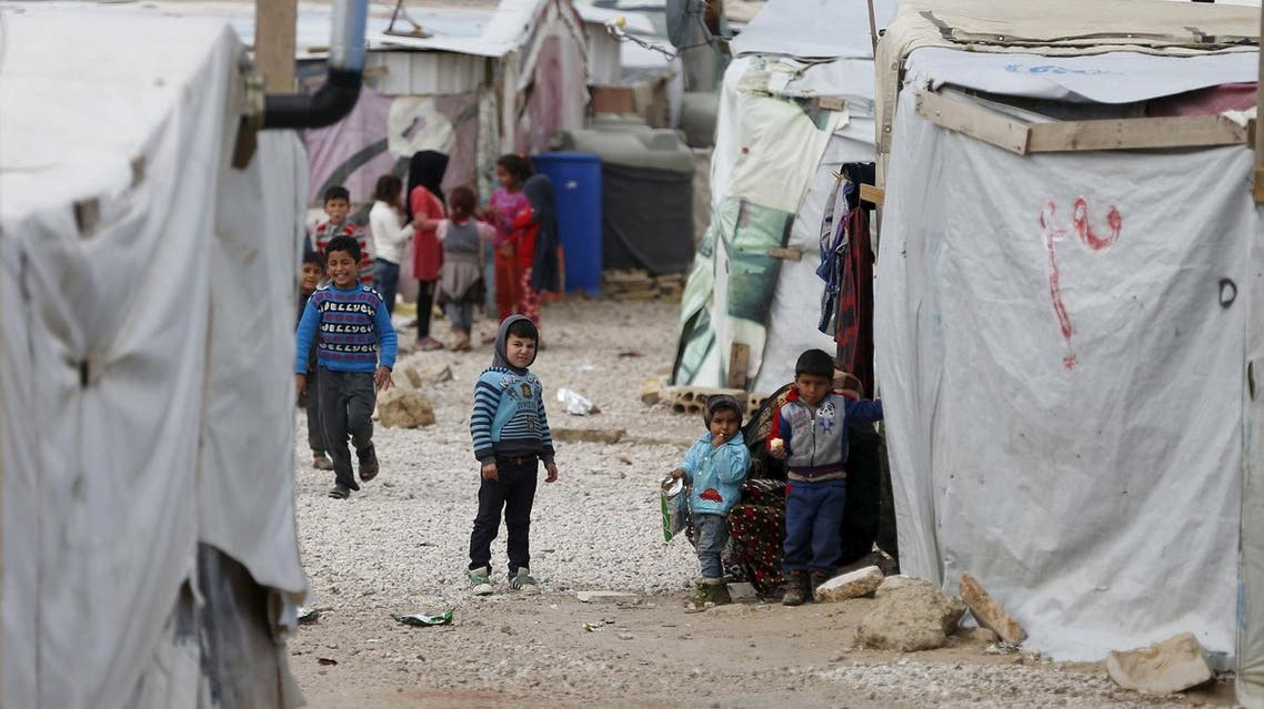 Syrian refugee children are seen outside their makeshift house at an unofficial refugee camp in the village of Deir Zannoun in Lebanon's Bekaa valley on January 31, 2017. Reuters