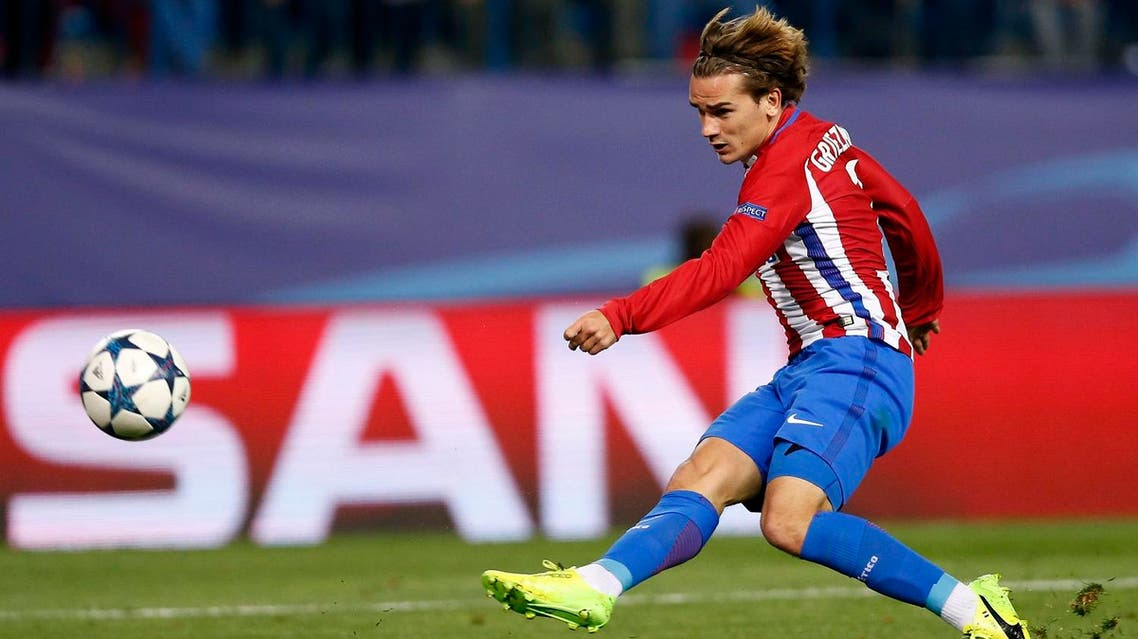 Atletico's Antoine Griezmann kicks the ball during the Champions League round of 16 second leg soccer match between Atletico Madrid and Bayer Leverkusen at the Vicente Calderon stadium in Madrid, Spain, Wednesday, March 15, 2017. (AP)