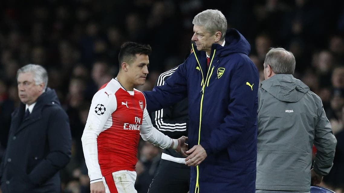 Arsenal's French manager Arsene Wenger (R) greets Arsenal's Chilean striker Alexis Sanchez after he is substituted during the UEFA Champions League last 16 second leg football match between Arsenal and Bayern Munich at The Emirates Stadium in London on March 7, 2017. (AFP)