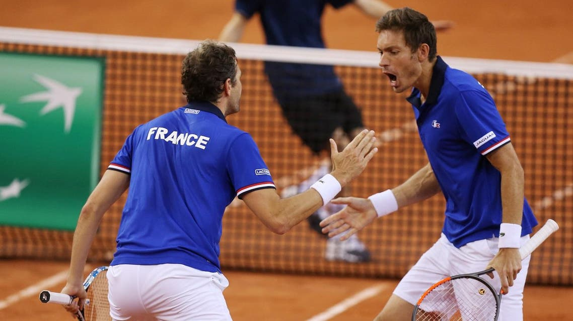 France's Nicolas Mahut and Julien Benneteau react during the Davis Cup world group quarter-final tennis match between France and Britain. (AFP)