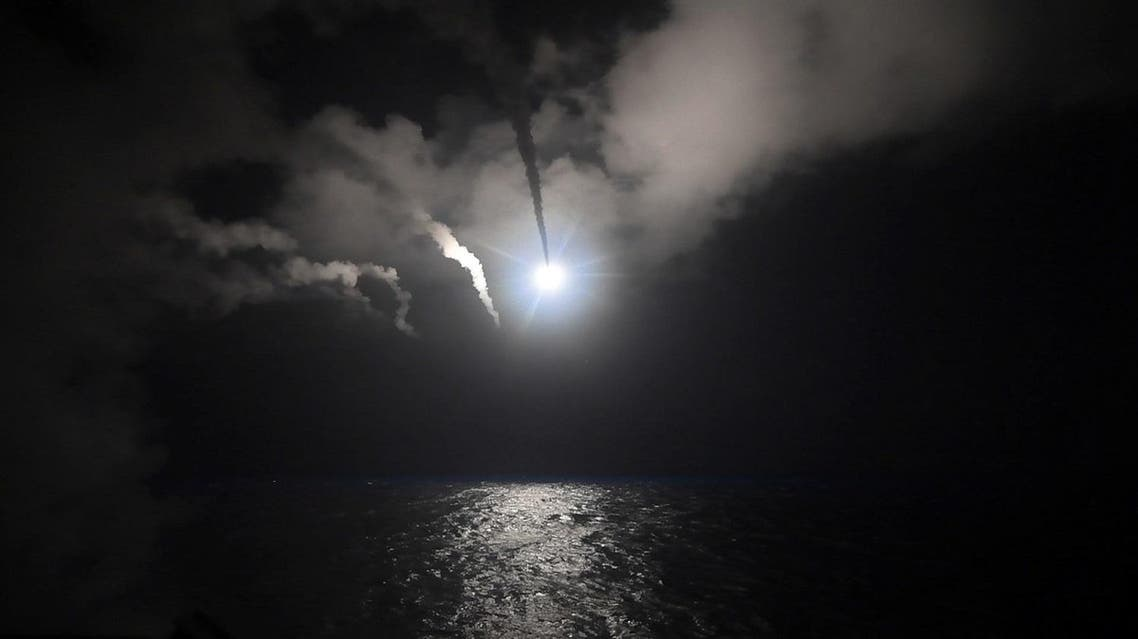 In this file image provided on Friday, April 7, 2017 by the US Navy, the guided-missile destroyer USS Porter (DDG 78) launches a tomahawk land attack missile in the Mediterranean Sea (Mass Communication Specialist 3rd Class Ford Williams/US Navy via AP)