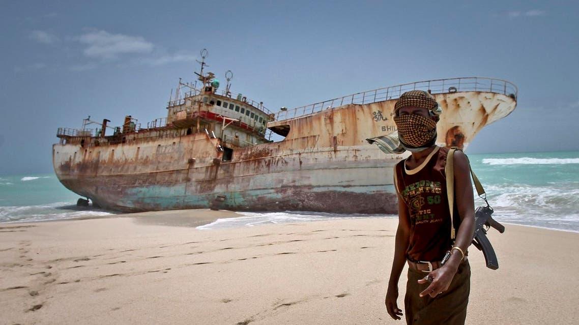 A masked Somali pirate Abdi Ali stands near a Taiwanese fishing vessel (File Photo: AP/Farah Abdi Warsameh)