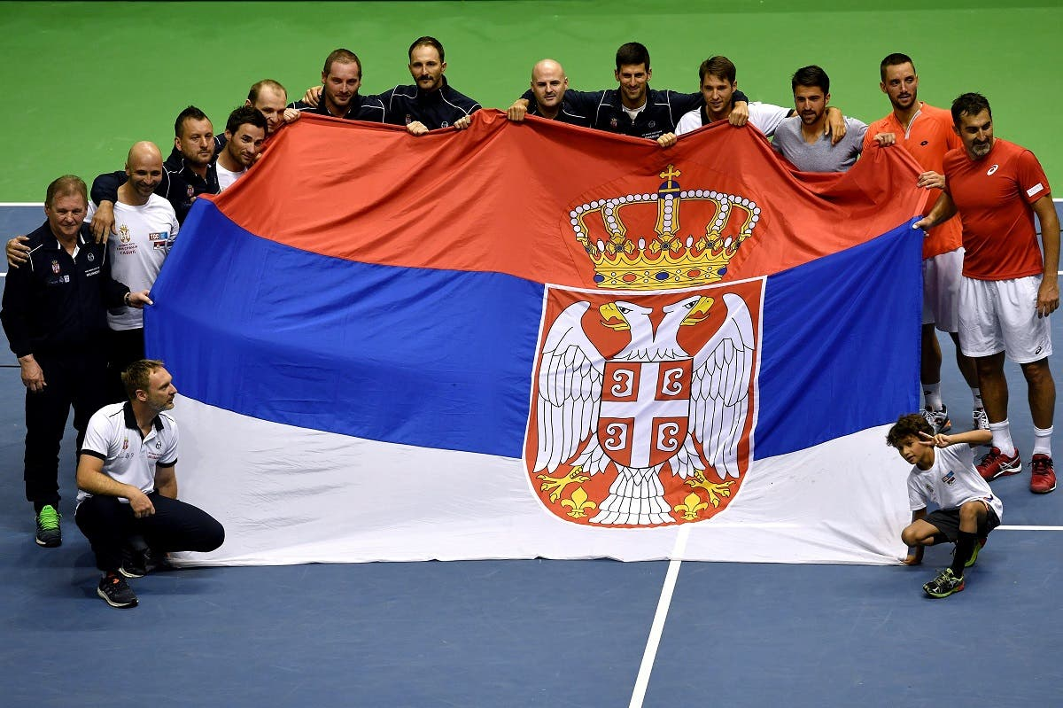 Serbia's tennis team celebrate their victory after the Davis Cup World Group quarter-final between Serbia and Spain. (AFP)