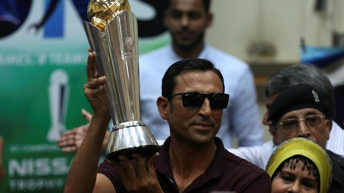 Pakistan's former cricket captain Younis Khan displays the 2017 ICC Champions Trophy during a ceremony at the University of Karachi, Pakistan, on March 30, 2017. (Reuters)