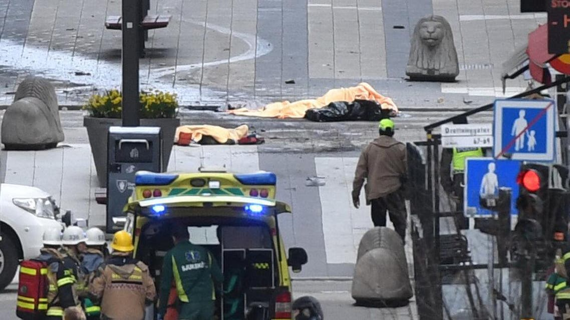 Several dead bodies are seen after a truck crashed into a department store Ahlens, in central Stockholm. (Reuters)