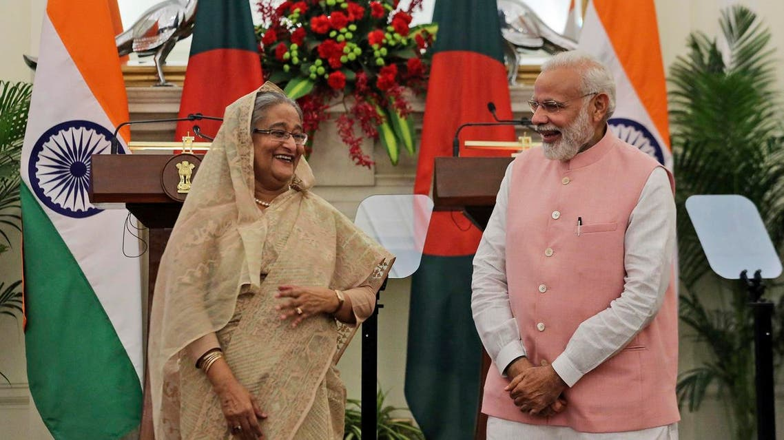 Indian Prime Minister Narendra Modi and his Bangladeshi counterpart Sheikh Hasina share a laugh after a signing of agreements in New Delhi, India, Saturday, April 8, 2017. (AP)
