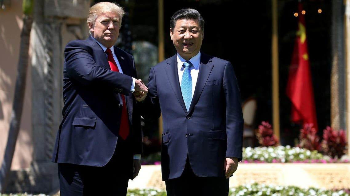 Donald Trump  and Xi Jinping shake hands while walking at Mar-a-Lago estate after a bilateral meeting in Palm Beach, Florida, on April 7, 2017. (Reuters)