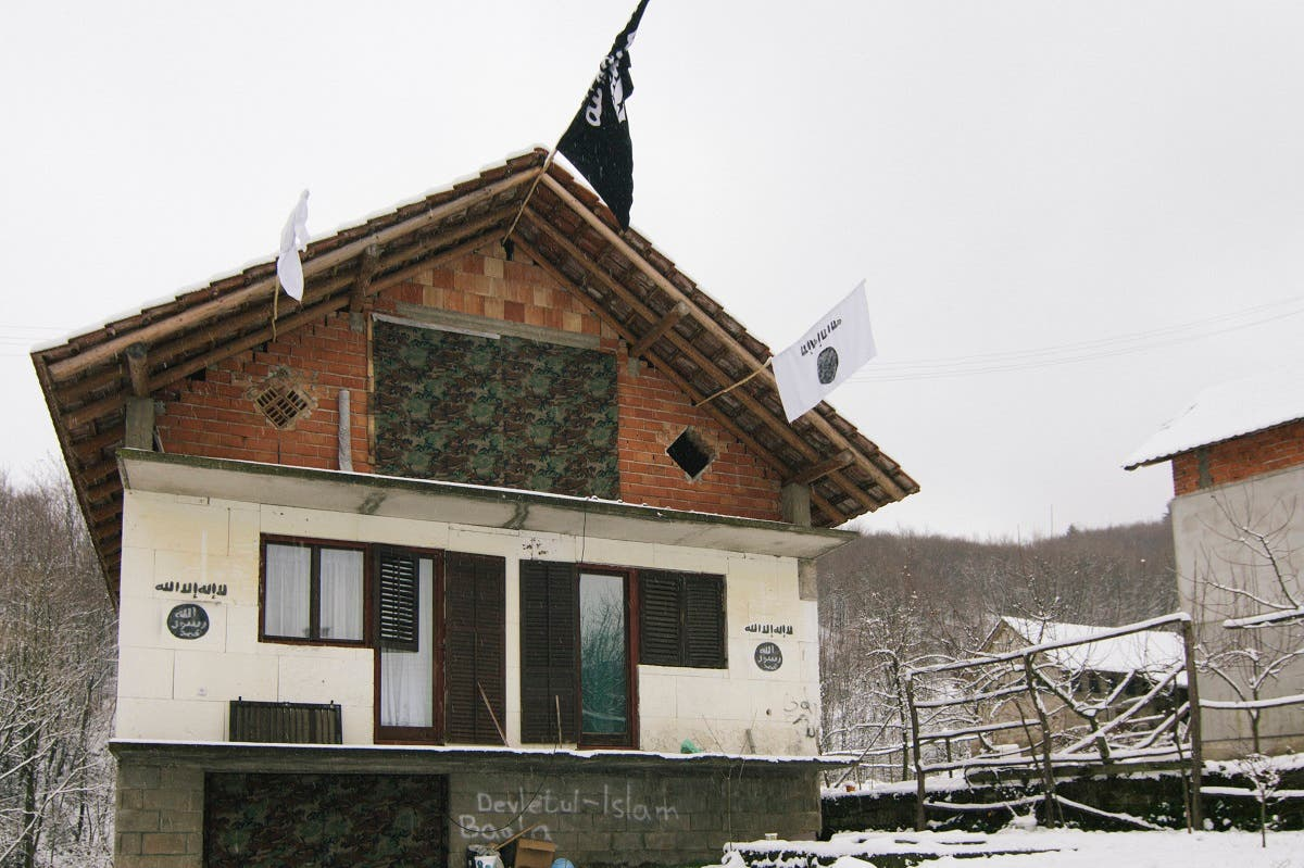 A house in the Bosnian village of Gornja Maoca decorated with ISIS flags, January 26, 2015. (Reuters)