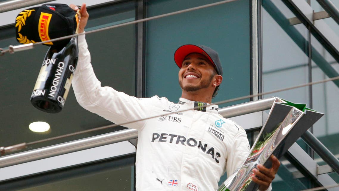 Mercedes driver Lewis Hamilton of Britain acknowledges cheering of spectators before leaving the podium after winning the Chinese Formula One Grand Prix at the Shanghai International Circuit in Shanghai, China, Sunday, April 9, 2017. (AP)