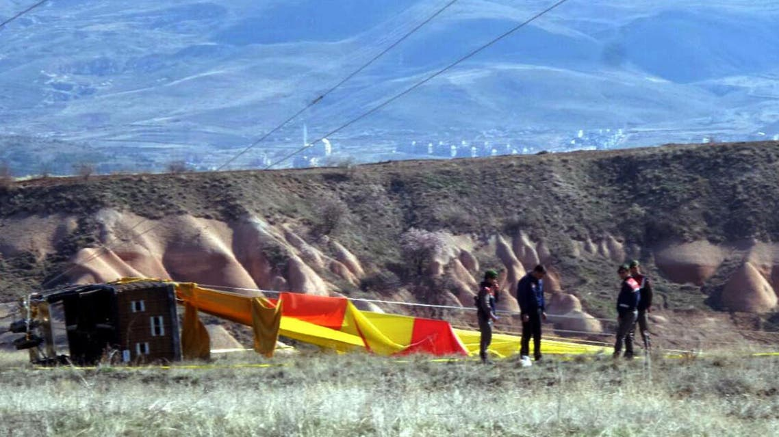Security members investigate at the site after a hot air balloon hit a high-voltage transmission line and crashed near Cappadocia, a popular tourist destination in central Turkey, Sunday, April 9, 2017. (AP)