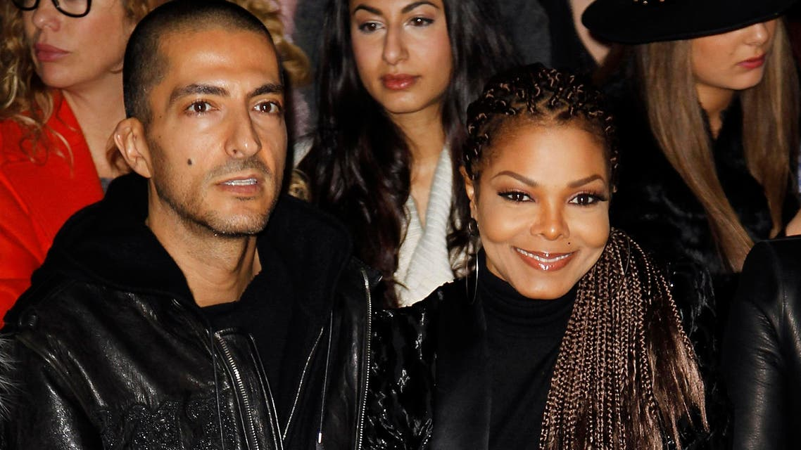 Janet Jackson (R) and her boyfriend Wissam Al Mana attend the Roberto Cavalli Autumn/Winter 2013 collection at Milan Fashion Week February 23, 2013. (Reuters)