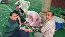 Muslim Egyptians donate blood to deadly church blast victims