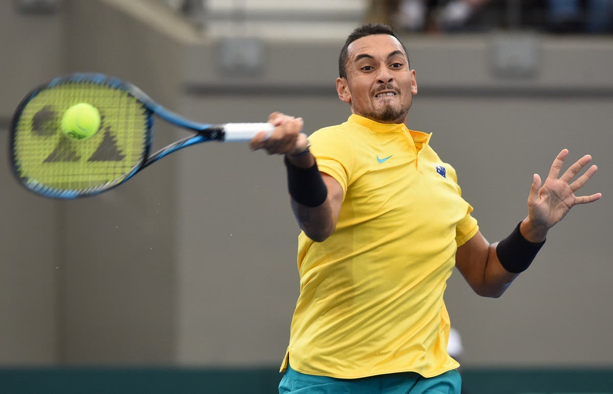 Nick Kyrgios hits a shot during his Davis Cup quarter-final match against Sam Querrey of the USA. (Reuters)