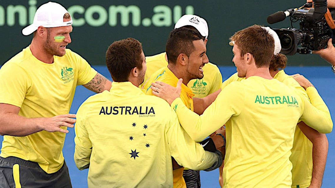 Kyrgios stepped it up a notch and won the last five games of the match, jumping up and hugging Australian captain Lleyton Hewitt and his teammates when the match ended. (Reuters)