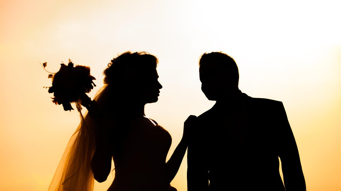 Silhouette of Bride and groom outdoor wedding