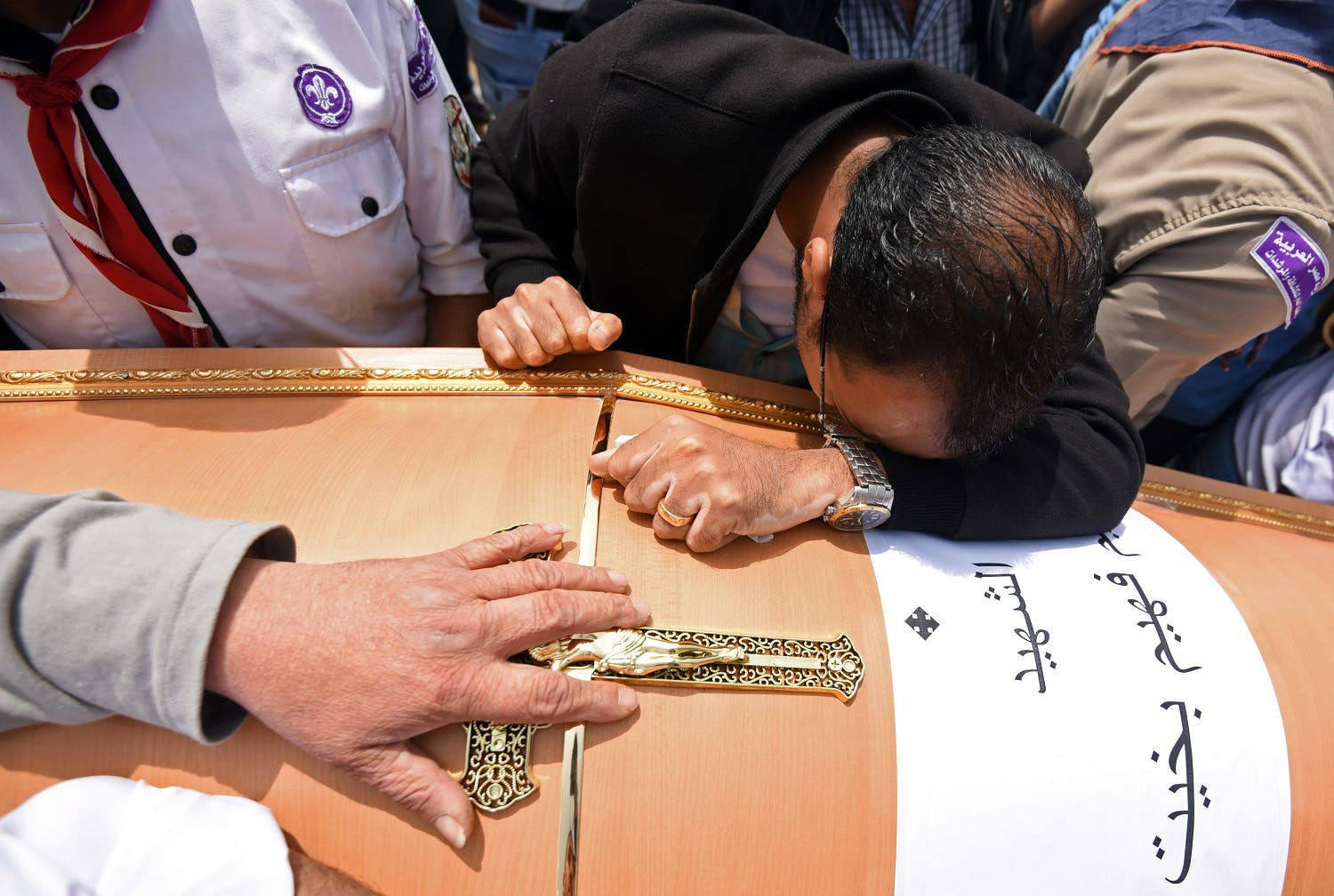 Men mourn over the coffin of one of the victims of the blast at the Coptic Christian Saint Mark's church in Alexandria the previous day during a funeral procession at the Monastery of Marmina in the city of Borg El-Arab, east of Alexandria, on April 10, 2017. Egypt prepared to impose a state of emergency after jihadist bombings killed dozens at two churches in the deadliest attacks in recent memory on the country's Coptic Christian minority. (AFP)