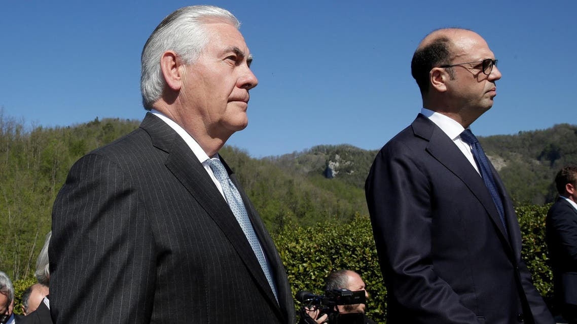 U.S. Secretary of State Rex Tillerson (L) and Italy's Foreign Minister Angelino Alfano arrive to attend a ceremony at the Sant'Anna di Stazzema memorial, dedicated to the victims of the massacre committed in the village of Sant'Anna di Stazzema by Nazis in 1944 during World War II, Italy April 10, 2017. (Reuters)
