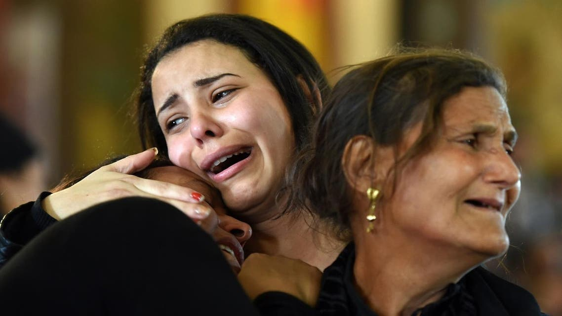 Women mourn for the victims of the blast at the Coptic Christian Saint Mark's church in Alexandria the previous day during a funeral procession at the Monastery of Marmina in the city of Borg El-Arab, east of Alexandria, on April 10, 2017. Egypt prepared to impose a state of emergency after jihadist bombings killed dozens at two churches in the deadliest attacks in recent memory on the country's Coptic Christian minority. AFP