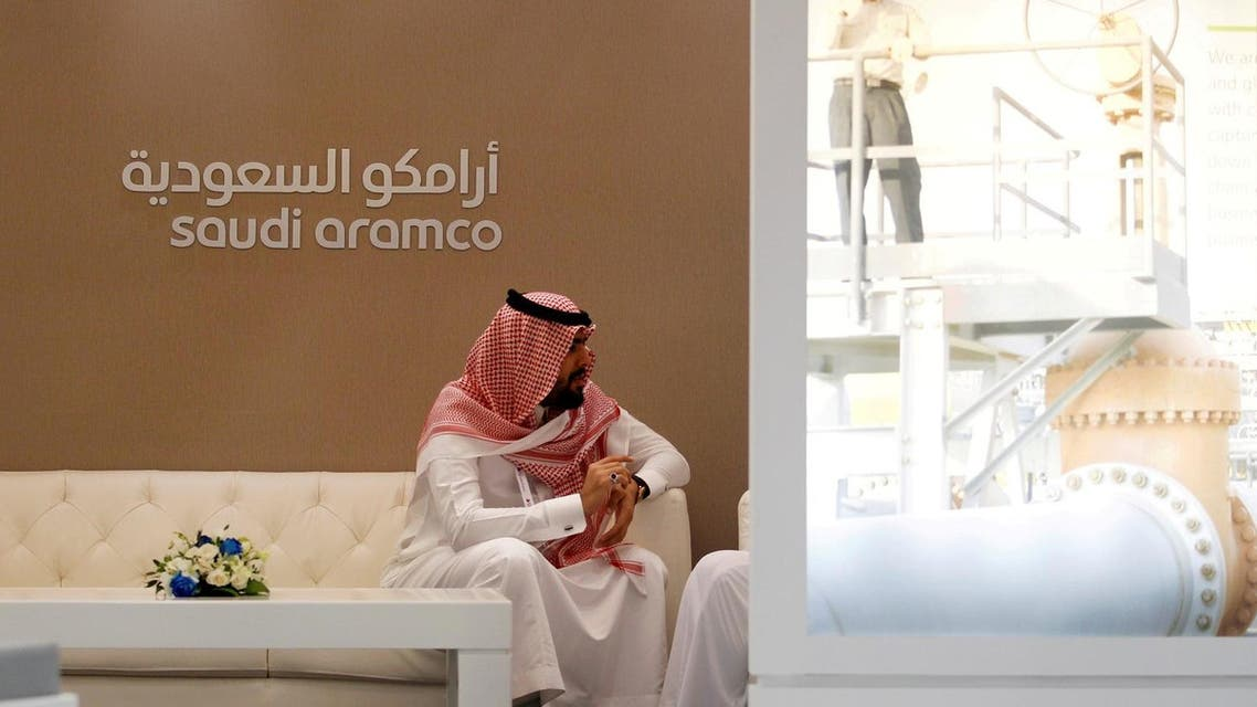 A Saudi Aramco employee sits in the company stand at the Middle East Petrotech 2016, an exhibition and conference for the refining and petrochemical industries, in Manama, Bahrain, September 27, 2016. (Reuters)