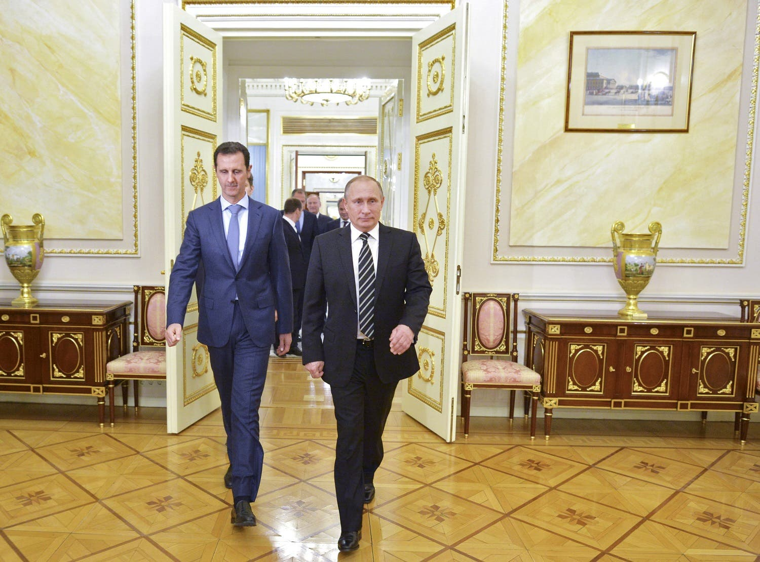 Russian President Vladimir Putin (R) and Syrian President Bashar al-Assad enter a hall during a meeting at the Kremlin in Moscow, Russia, October 20, 2015. To match INSIGHT MIDEAST-CRISIS/SYRIA-ALEPPO-FALL Alexei Druzhinin/RIA Novosti/Kremlin/via REUTERS/File Photo ATTENTION EDITORS - THIS IMAGE HAS BEEN SUPPLIED BY A THIRD PARTY. Reuters