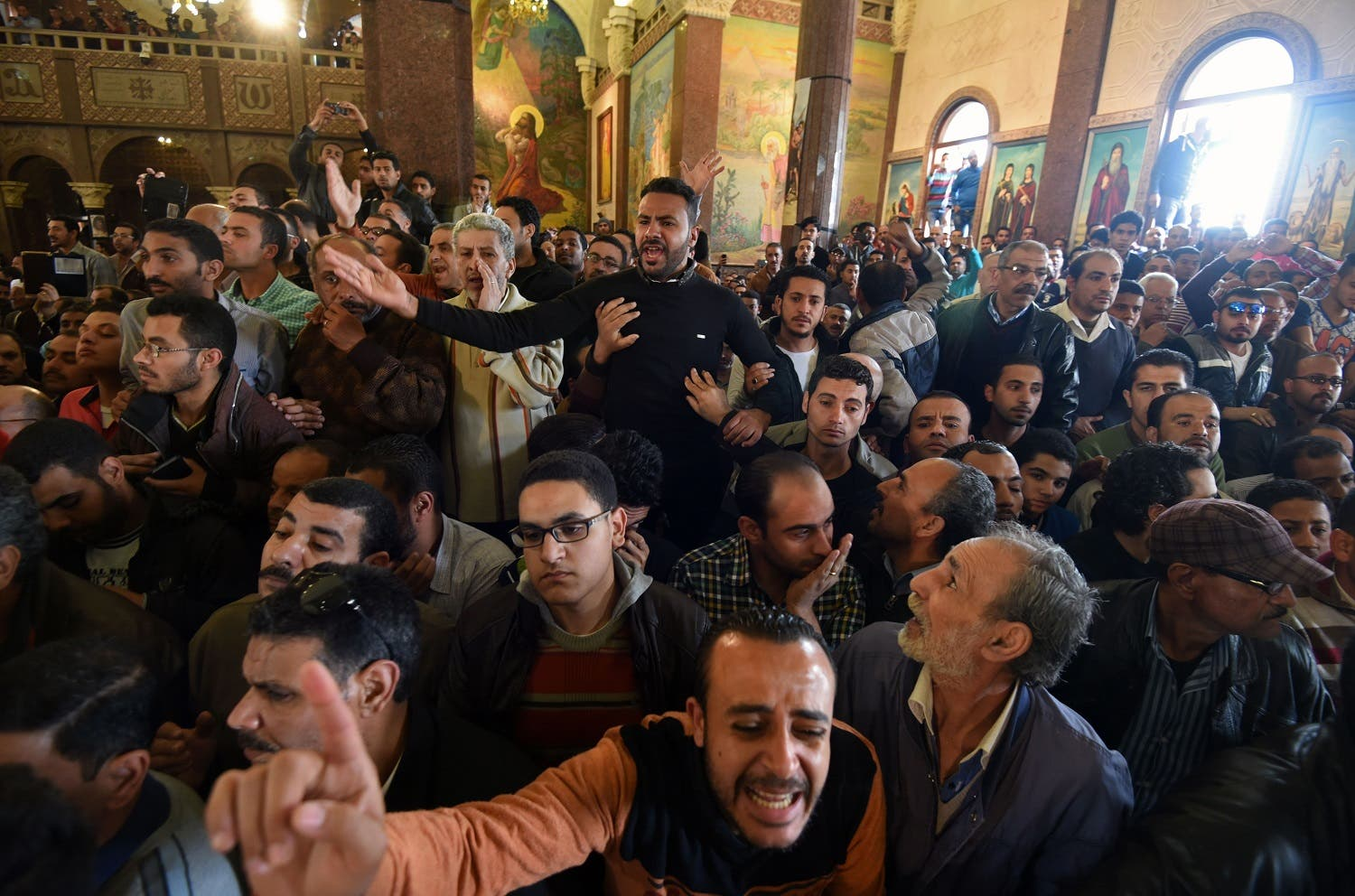 Men mourn for the victims of the blast at the Coptic Christian Saint Mark's church in Alexandria the previous day during a funeral procession at the Monastery of Marmina in the city of Borg El-Arab, east of the northern port city, on April 10, 2017. Egypt prepared to impose a state of emergency after jihadist bombings killed dozens at two churches in the deadliest attacks in recent memory on the country's Coptic Christian minority. (AFP)