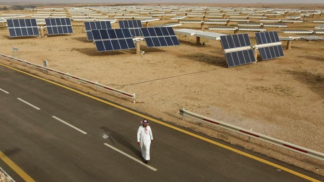A Saudi man walks on a street past a field of solar panels at the King Abdulaziz city of Sciences and Technology, Al-Oyeynah Research Station May 21, 2012. (Reuters)