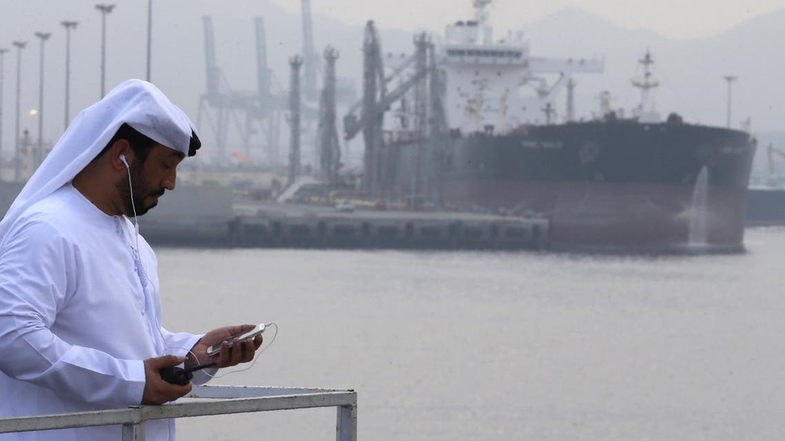 An Emirati man stands at the oil terminal of Fujairah during the inauguration ceremony of a dock for supertankers on September 21, 2016. (AFP)