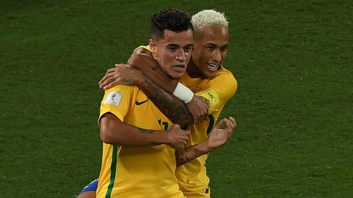 Brazil's Philippe Coutinho (L) celebrates his goal against Bolivia with teammate Neymar during their Russia 2018 World Cup qualifier football match in Natal, Brazil, on October 6, 2016. (AFP)
