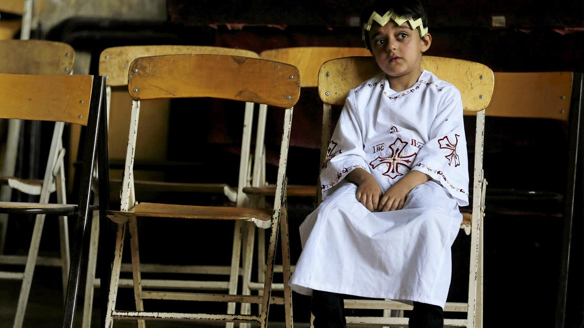 An Egyptian Coptic Orthodox Christian deacon boy looks on during a Palm Sunday mass in the Samaan el-Kharaz Monastery in the Mokattam Mountain area of Cairo, Egypt, April 24, 2016. REUTERS/Amr Abdallah Dalsh
