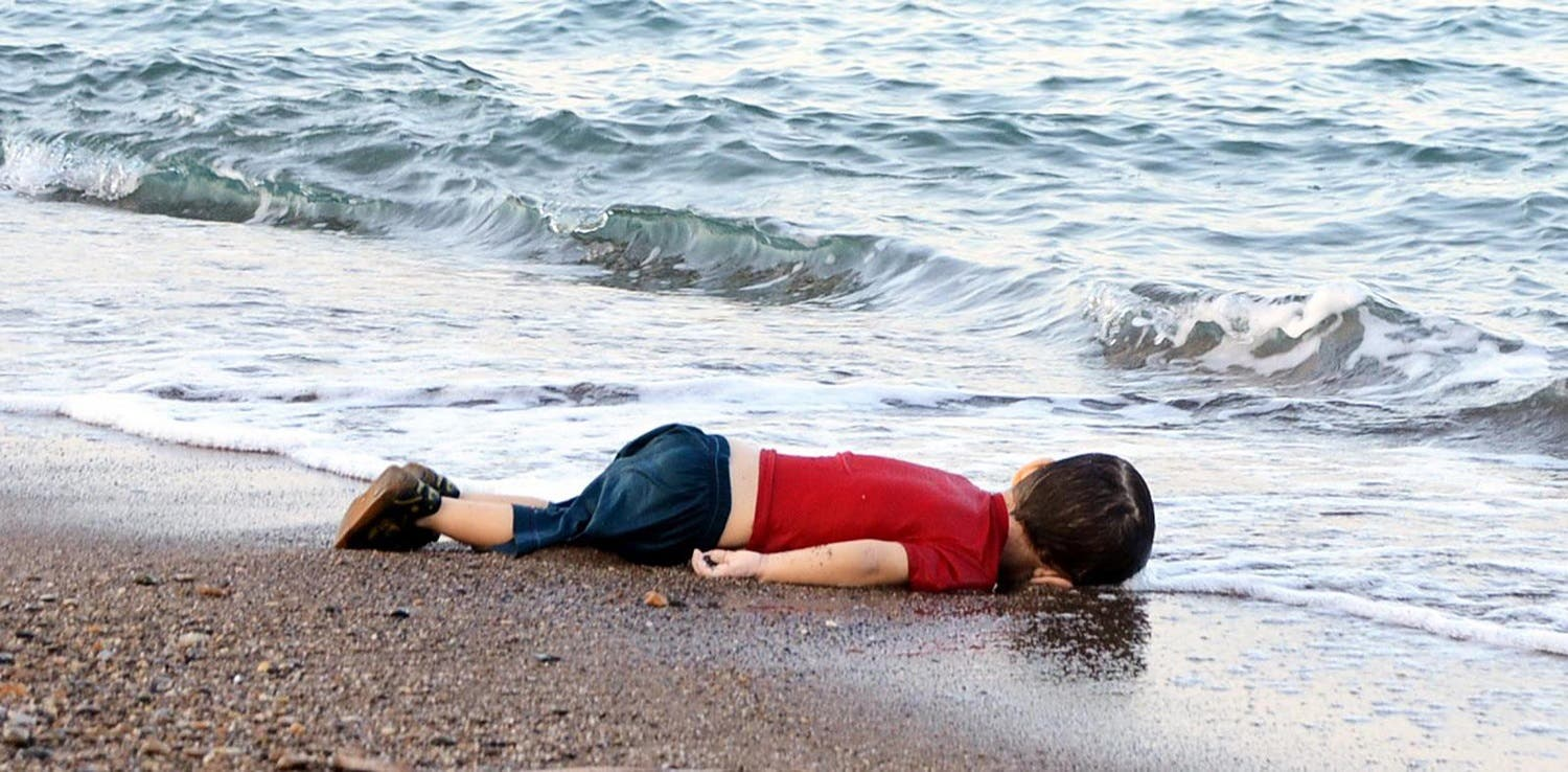 The body of Aylan Kurdi lies on the shores of Bodrum, southern Turkey, on September 2, 2015 after a boat carrying refugees sank while reaching the Greek island of Kos (File Photo: AFP/Nilufer Demir)