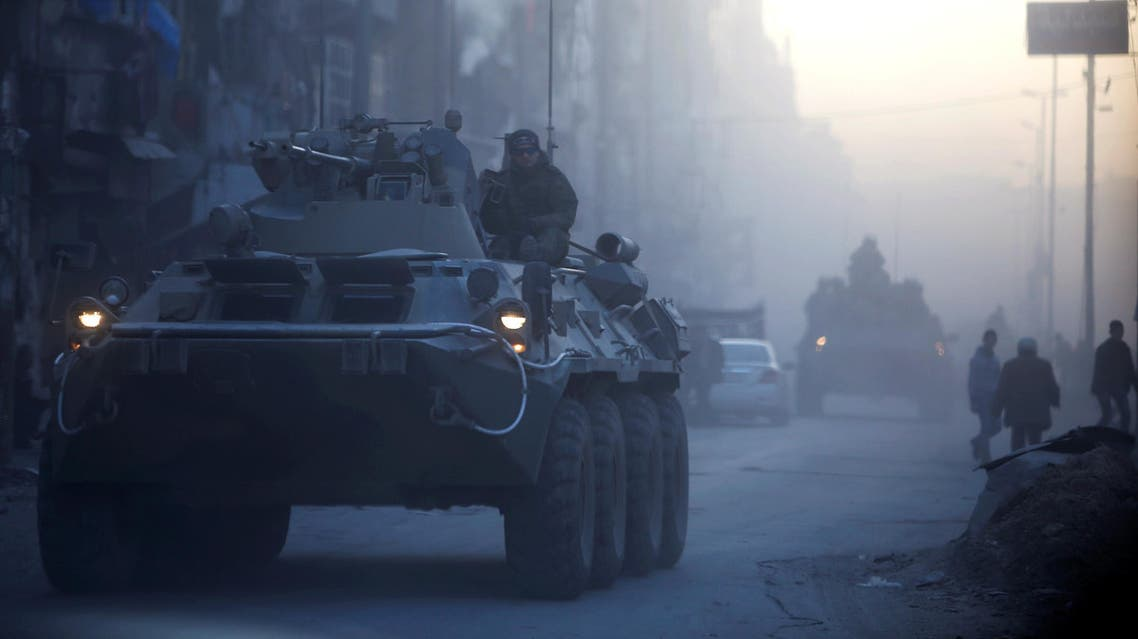 Russian soldiers, on armoured vehicles, patrol a street in Aleppo, Syria February 2, 2017. (Reuters)
