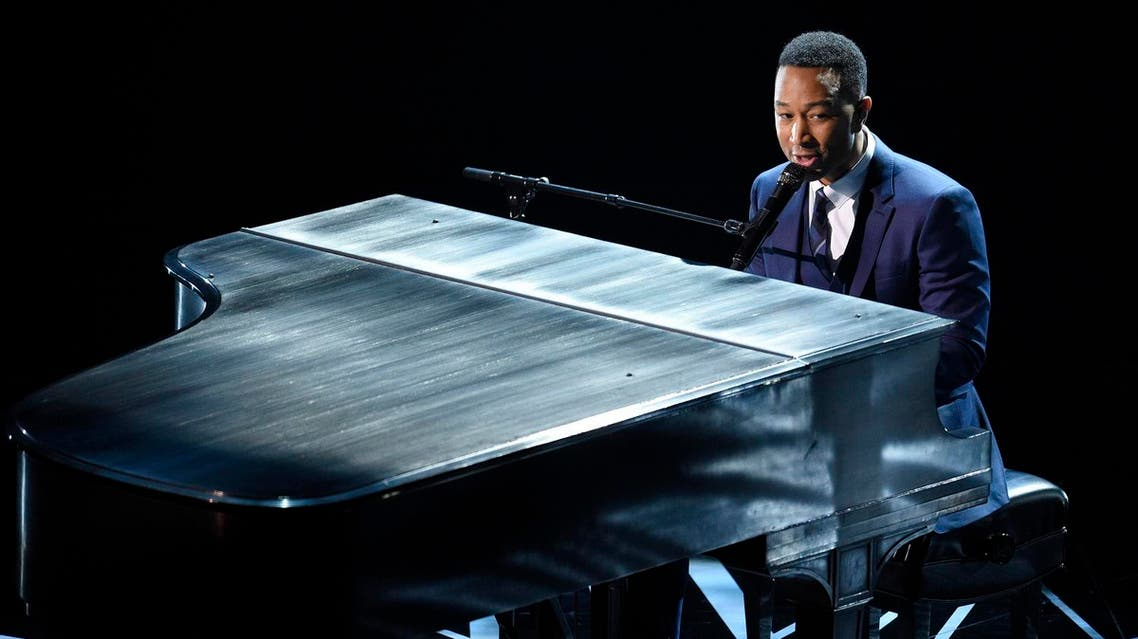 """John Legend performs songs from best original song nominees """"City of Stars"""" and """"Audition"""" from """"La La Land"""" at the Oscars on Sunday, Feb. 26, 2017, at the Dolby Theatre in Los Angeles. (Photo by Chris Pizzello/Invision/AP)"""