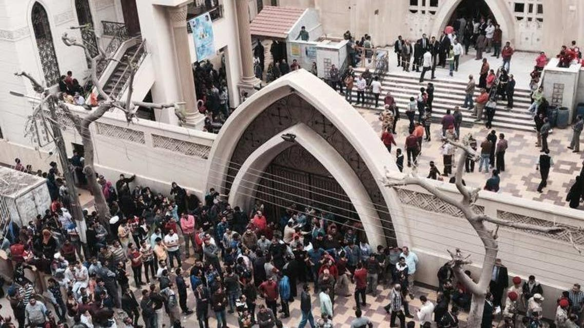 Egyptians stand outside the Egyptian Coptic church targeted by a suicide bomber (File Photo: AP)