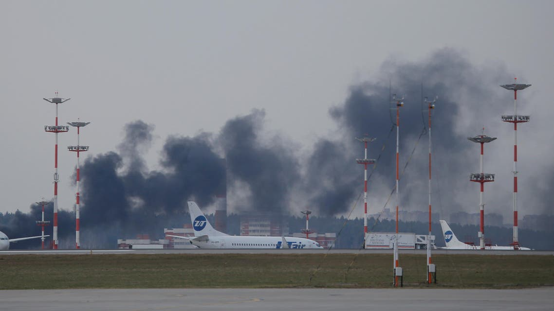 Smoke rises up from a part of the airfield where planes are parked, at Vnukovo International Airport in Moscow, Russia, April 11, 2017. REUTERS/Maxim Shemetov
