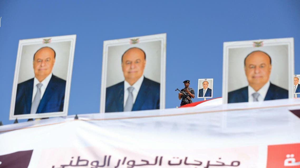 A police trooper stands by a poster of Yemen's President Abd-Rabbu Mansour Hadi on a government building during a demonstration to show support to Hadi in the country's northern city of Marib November 3, 2016. (Reuters)