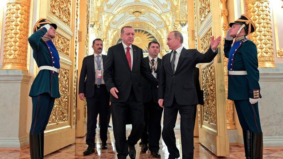 Vladimir Putin and Recep Tayyip Erdogan tour the Kremlin after talks in Moscow on March 10, 2017. (AP)