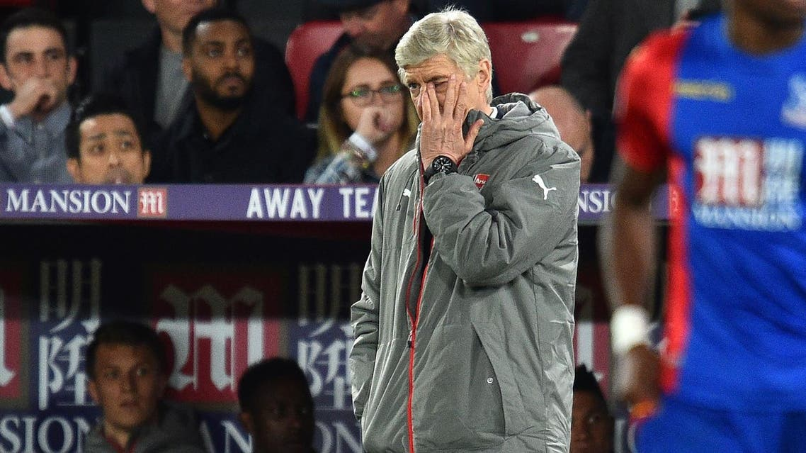 Arsenal's French manager Arsene Wenger watches from the touchline during the English Premier League football match between Crystal Palace and Arsenal at Selhurst Park in south London on April 10, 2017. Crystal Palace won the game 3-0. (AFP)