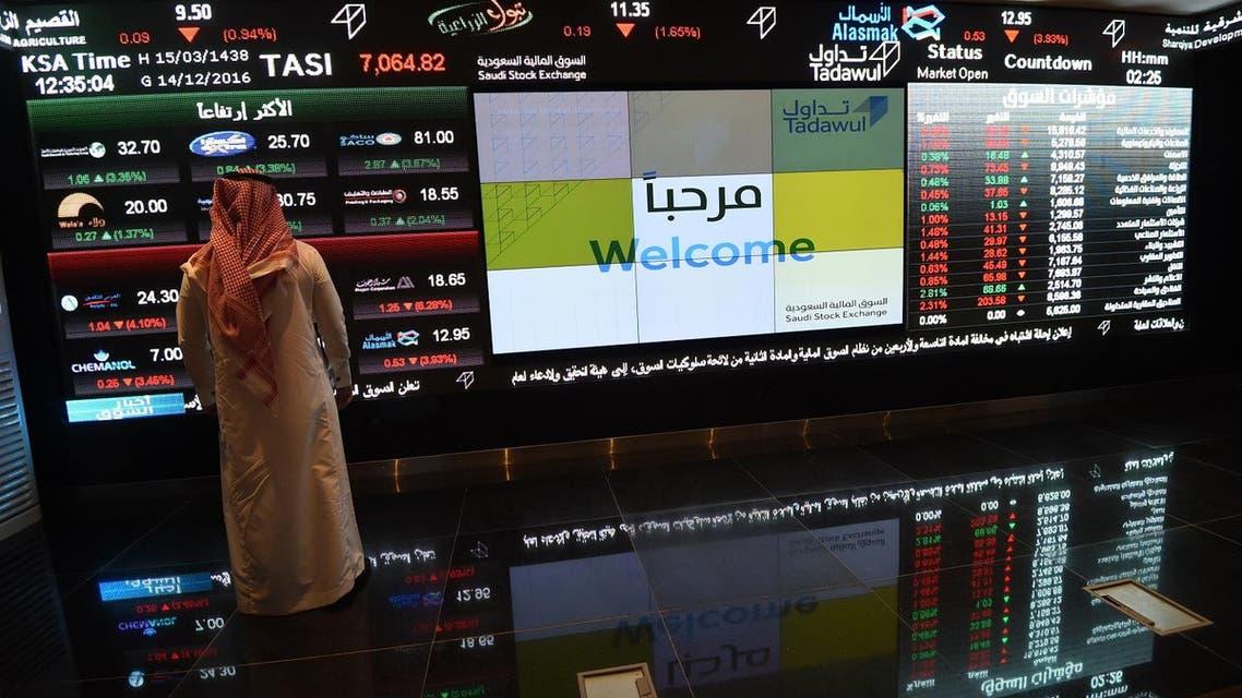 A Saudi investor monitors the stock exchange at the Saudi Stock Exchange, or Tadawul, on December 14, 2016 in Riyadh. (File photo: AFP)