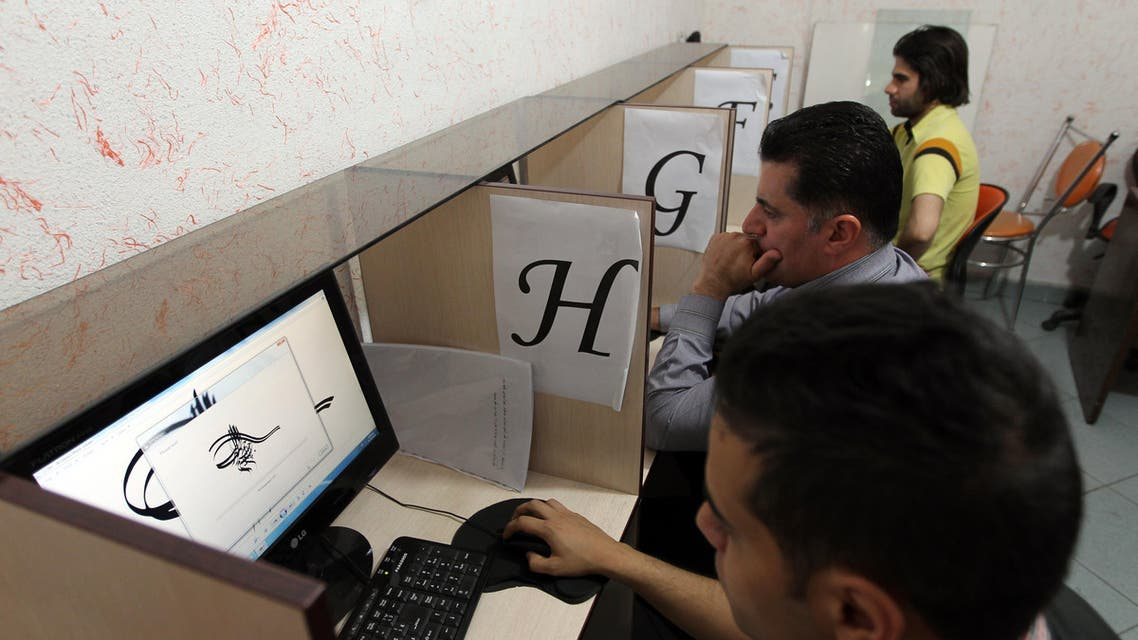 Iranians use computers at a cybercafe in the center of the Iranian capital Tehran on May 14, 2013