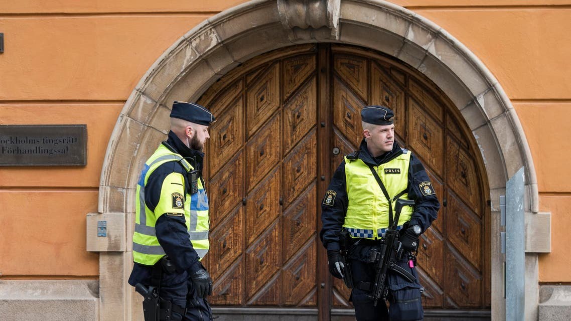 Policemen secure the entrance to the Stockholm District Court where Uzbek national Rakhmat Akilov (not in picture), prime suspect in the Stockholm truck attack, appeared in court on April 11, 2017. (AFP)