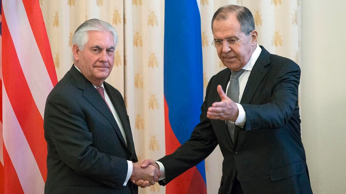 US Secretary of State Rex Tillerson and Russian Foreign Minister Sergey Lavrov, shakes hands prior to their talks in Moscow, Russia, Wednesday, April 12, 2017. Tillerson's Moscow talks hinge on new US leverage over Syria. (AP)